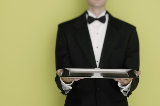 Waiter holding tray : Stock Photo