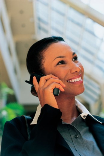 Stock Photo: 1557R-0381 Woman using cellular phone