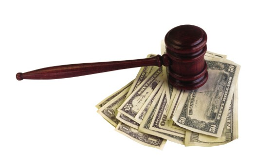 Gavel on top of money : Stock Photo