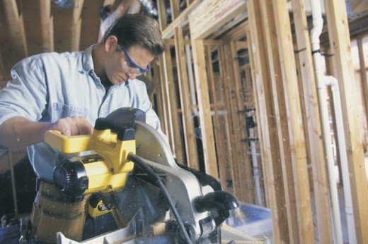 Stock Photo: 1557R-05673 Construction worker using a miter saw