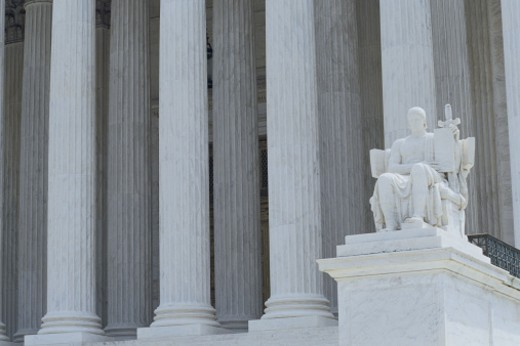 Doric columns and statue : Stock Photo