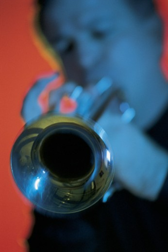 Stock Photo: 1557R-06009 Man playing trumpet