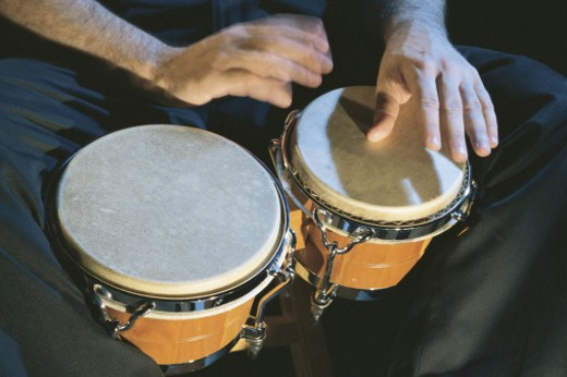 Hands playing bongos : Stock Photo