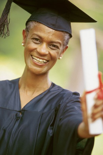 Stock Photo: 1557R-0664 Adult graduate with diploma