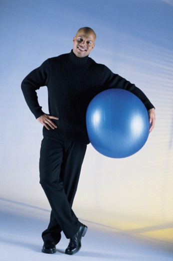 Man holding ball : Stock Photo