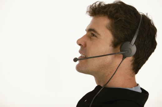 Man with phone headset : Stock Photo
