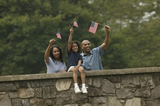 Stock Photo: 1557R-07885 Family waving American flags