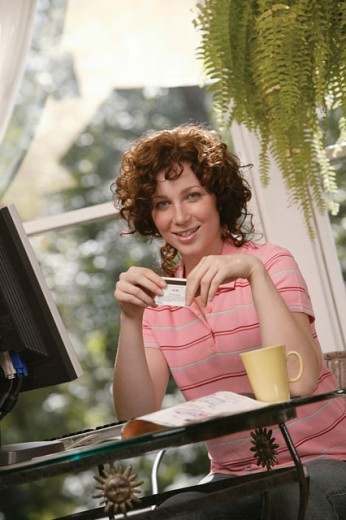 Woman shopping online : Stock Photo