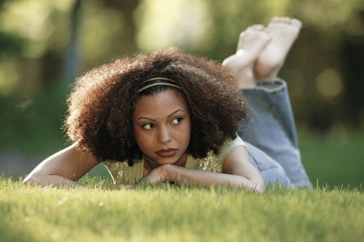 Woman lying in grass : Stock Photo