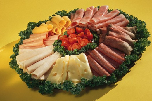 Stock Photo: 1557R-137019 Platter of assorted cheeses and meats with garnish
