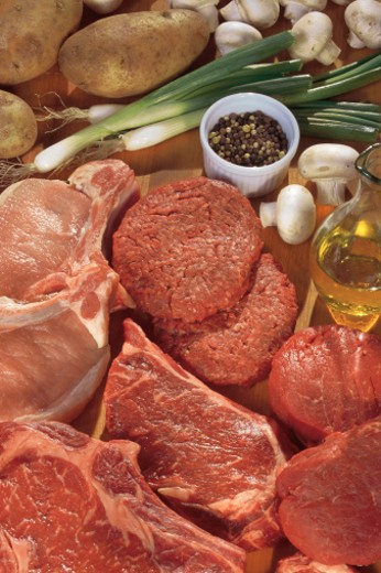 Assorted raw meat and ingredients for cooking : Stock Photo
