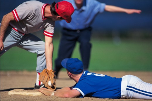 Stock Photo: 1557R-164031 Baseball player sliding into base safely