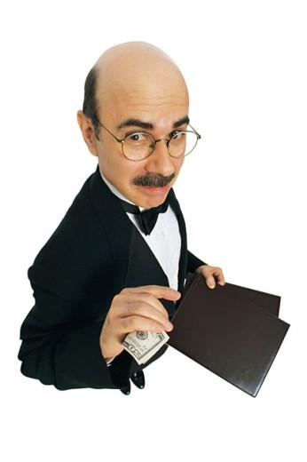Pretentious waiter taking tip : Stock Photo