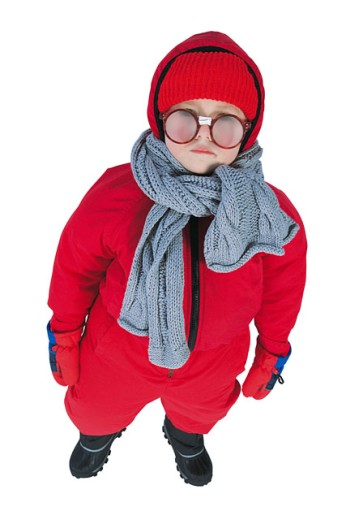 Little boy with glasses bundled up for winter : Stock Photo