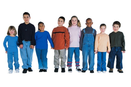Group of kids standing side-by-side holding hands : Stock Photo
