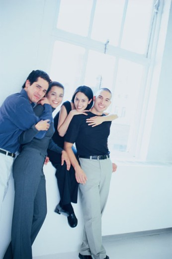 Smiling couples embracing : Stock Photo