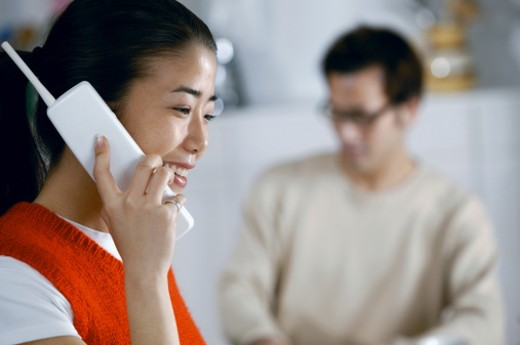Stock Photo: 1557R-265100 Woman talking on telephone