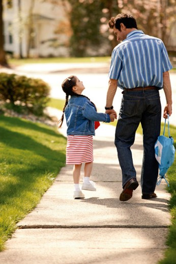 Stock Photo: 1557R-267073 Father and daughter walking to school