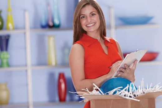 Woman taking inventory in retail store : Stock Photo