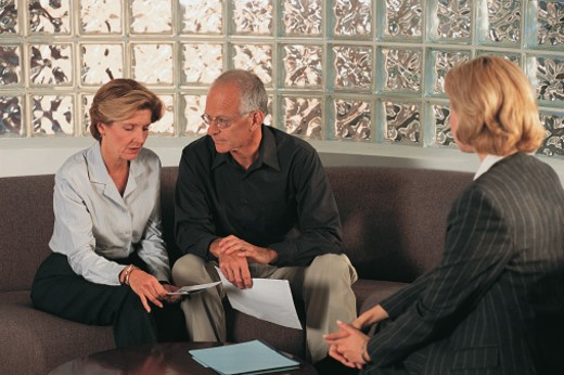 Couple talking with businesswoman : Stock Photo