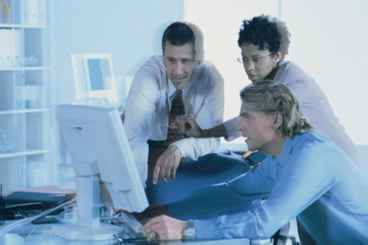 Businesspeople using computer : Stock Photo