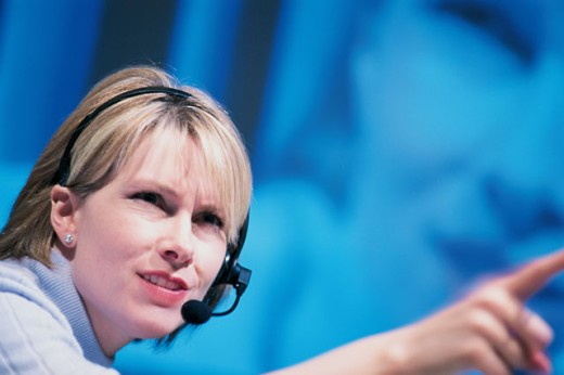 Woman with microphone pointing : Stock Photo