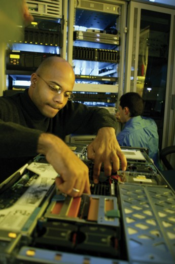 Stock Photo: 1557R-276529 Technician working on a computer server