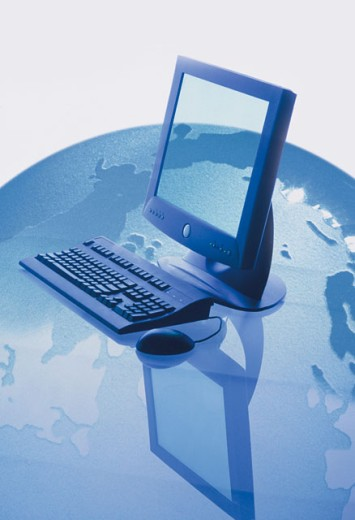 Stock Photo: 1557R-276541 Computer on top of a globe
