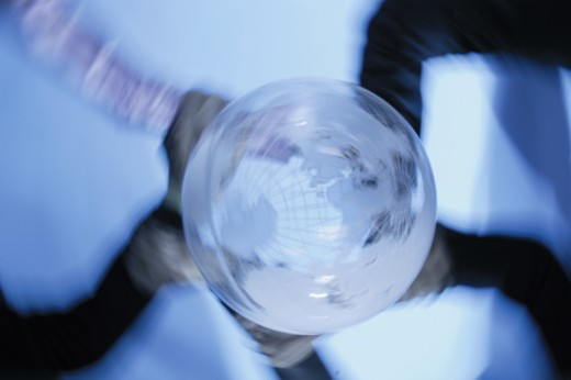 Stock Photo: 1557R-276647 Spinning globe on hands
