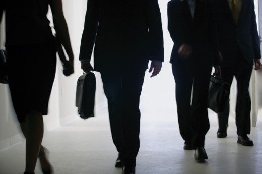 Stock Photo: 1557R-276690 Businesspeople walking in a hallway