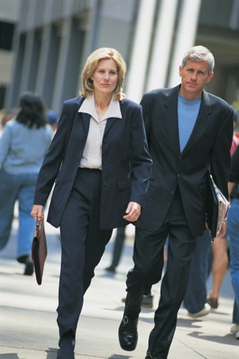 Stock Photo: 1557R-276700 Businesspeople walking