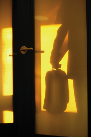 Shadow of man through door : Stock Photo