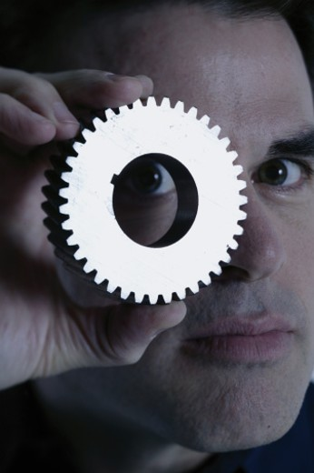 Man with a gear : Stock Photo