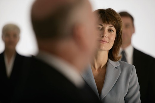 Businesswoman among colleagues : Stock Photo