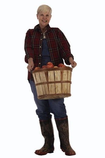 Farmer with bushel of apples : Stock Photo