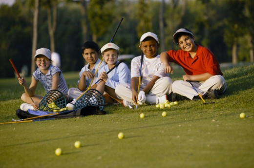 Children practicing golf : Stock Photo