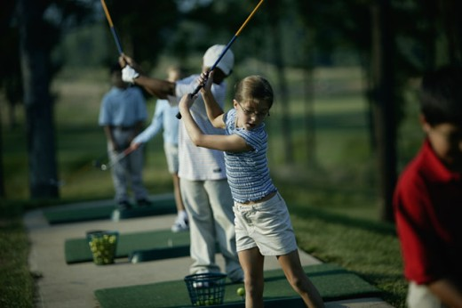 Children practicing at a driving range : Stock Photo