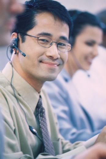 Businessman at call center : Stock Photo