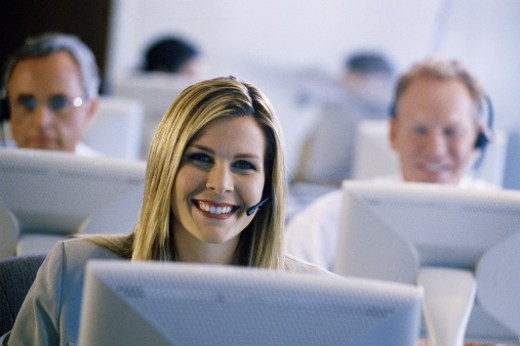Woman working at a call center : Stock Photo
