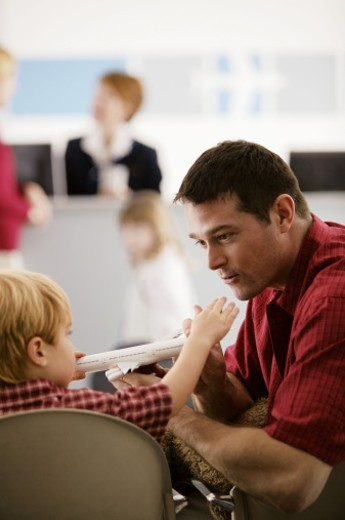 Father and son in airport : Stock Photo