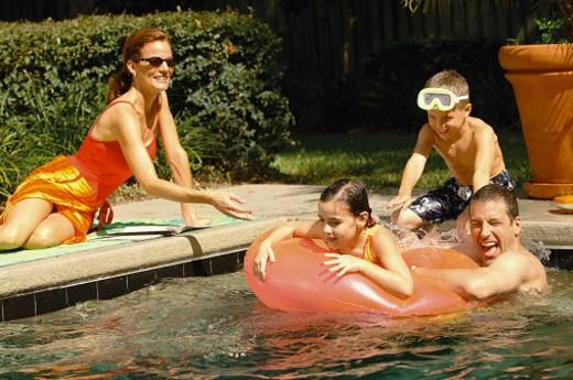 Family at pool : Stock Photo