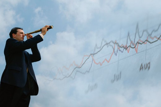 Stock Photo: 1557R-277677 Businessman using telescope and stock market graph