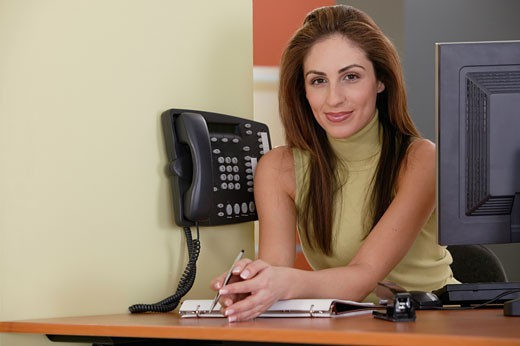 Woman at front desk of business : Stock Photo
