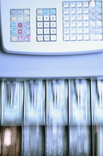 Motion blur of a cash register opening : Stock Photo