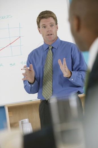 Businessman talking at a presentation : Stock Photo