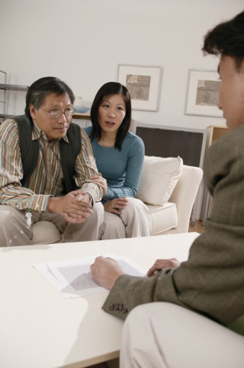 Stock Photo: 1557R-278862 Couple meeting with businessman