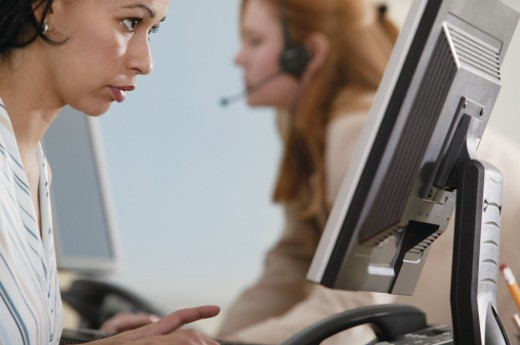 Stock Photo: 1557R-279187 Woman in office at computer