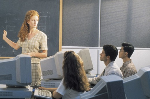 Teacher and students in classroom : Stock Photo