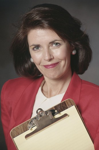 Portrait of woman with clipboard : Stock Photo