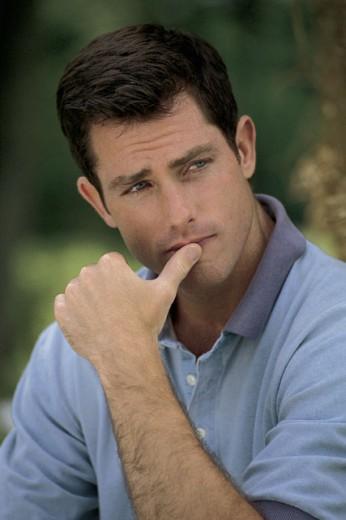 Stock Photo: 1557R-279857 Portrait of pensive man outdoors